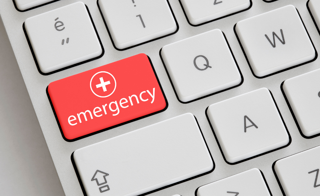 Crisis L&D: Keyboard with emergency key in red